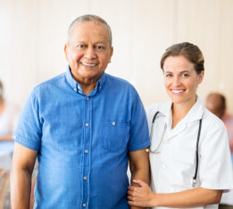 nurse and senior man smiling