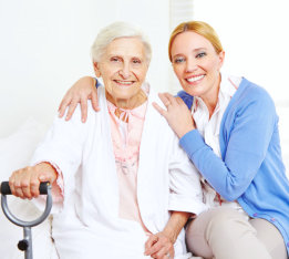 adult woman and senior woman smiling