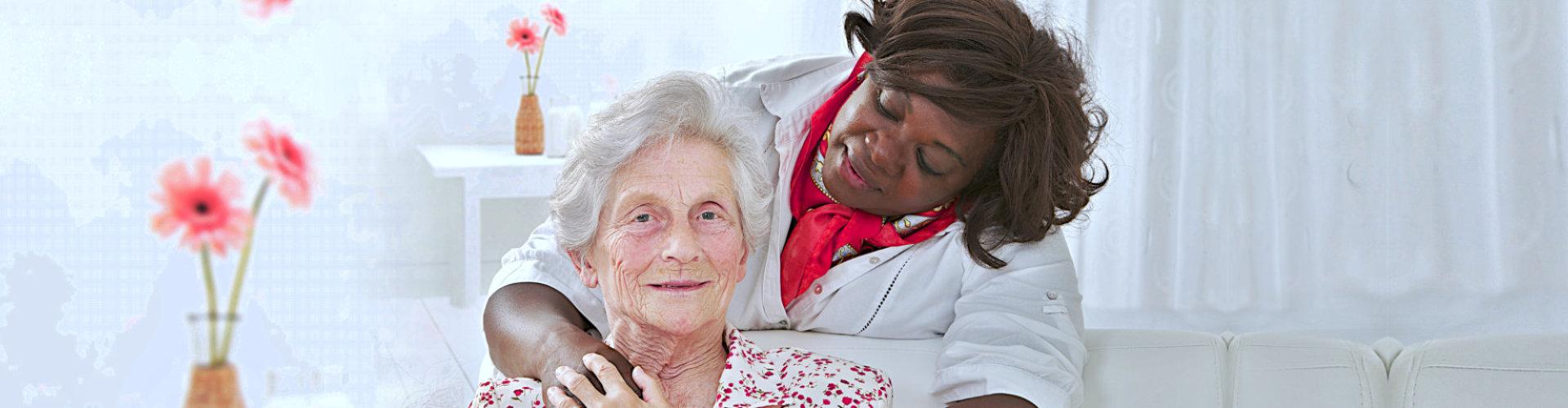 happy senior woman with friendly female nurse